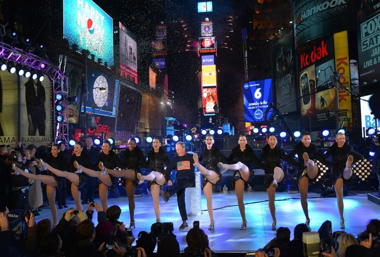 New York City Mayor Michael Bloomberg (C) celebrates New Year's Eve 2013 In Times Square with the Rockettes at Times Square in New York City. (Mike Coppola/Getty Images)