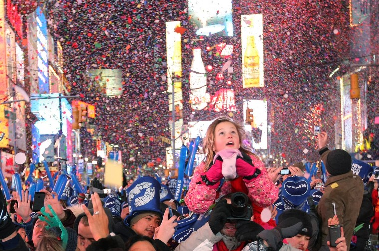 People celebrate as the stroke of midnight rings in the new year in Times Square on January 1, 2013 in New York City. Approximately one million people are expected to ring in the new year in Times Square. (Monika Graff/Getty Images)