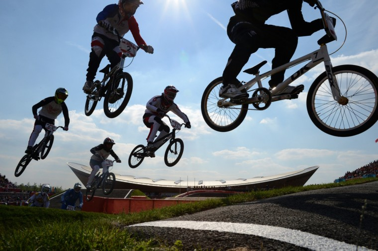 Australia's Marc Willers (R), Switzerland's Roger Rinderknecht (C, #13), Joris Daudet (Upper #2) of France, Nicholas Long of the US (L,#64) and compatriot David Herman (lower, 2nd L, #5) compete during the men's BMX cycling heat at the London 2012 Olympic Games, in London on August 9, 2012. (Carl De Souza/GettyImages)