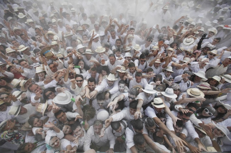 """People throw talcum powder at one another as they take part in the carnival """"Los Indianos"""" (the Indians) in Santa Cruz de la Palma, on the Spanish Canary island of Las Palma on February 20, 2012. (Desireee Martin/Getty Images)"""