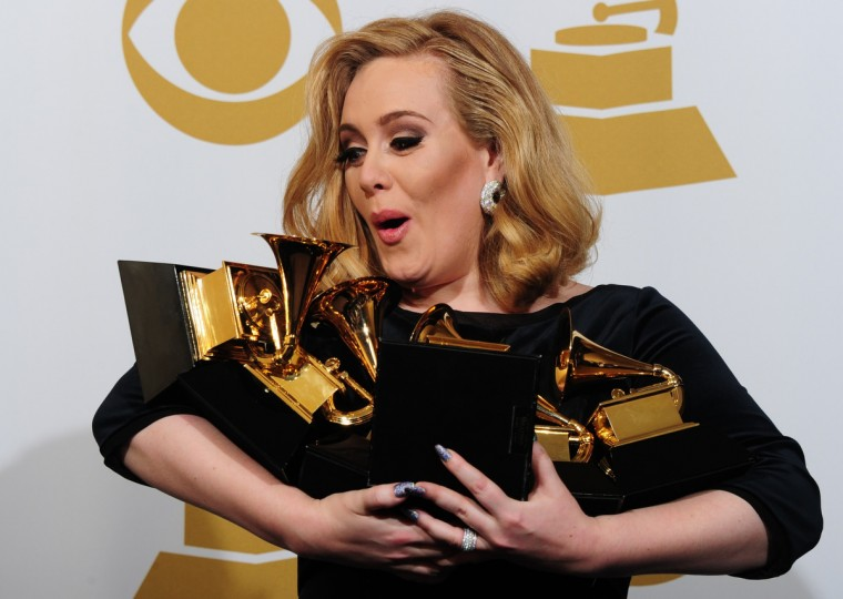 Musician Adele poses with her six trophies at the 54th Grammy Awards in Los Angeles, California, February 12, 2012. (Frederic J. Brown/Getty Images)