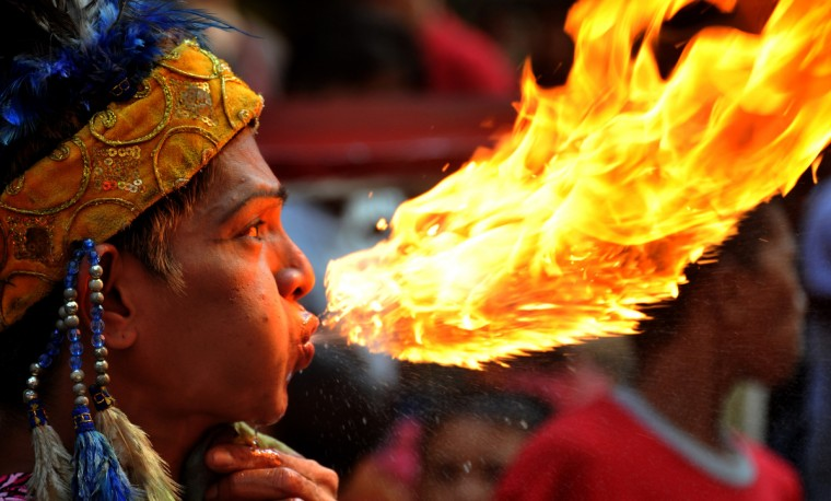 A fire breather performs in Chinatown in Manila a day before the Chinese New Year on January 22, 2012. The Lunar New Year falls on January 23 and is the beginning of the Spring Festival holiday. (Noel Celis/Getty Images)