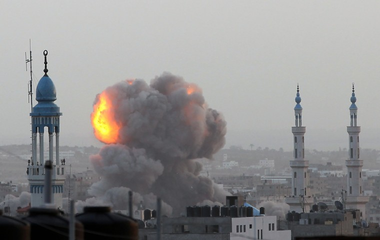 A fire ball rises as the Israeli air force carries out a raid over Gaza City on November 17, 2012, for the fourth consecutive day. Medics said 40 Gazans have been killed and more than 350 wounded since Israel launched an aerial campaign on the enclave on November 14, afternoon, with at least five militants among the 10 people killed in today's raids. (Majdi Fathi/Getty Images ORG XMIT: