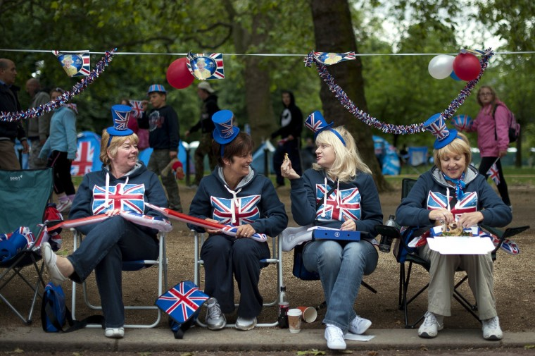 Royal supporters sit on chairs with Union Jack decorations on the Mall outside Buckingham Palace in London, on June 4, 2012, in preparation for the Queen's Jubilee concert. A chain of more than 4,200 beacons began to flare across the globe on June 4 to mark Queen Elizabeth II's diamond jubilee, with the last to be lit by the monarch at a star-studded concert at Buckingham Palace. (Ben Stansall/Getty Images)