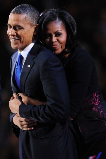 US President Barack Obama and his wife Michelle celebrate on stage after Obama delivered his acceptance speech on November 7, 2012 in Chicago. Obama swept to re-election, forging history again by transcending a slow economic recovery and the high unemployment which haunted his first term to beat Republican Mitt Romney. (Robyn Beck/Getty Images)