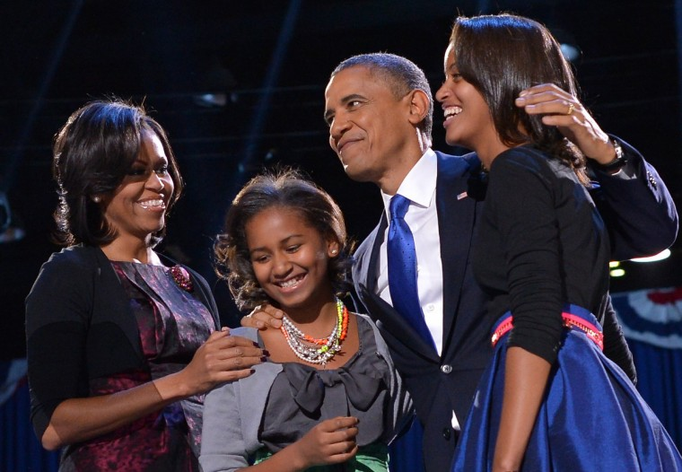 US President Barack Obama accompanied by (from L-R ) First Lady Michelle and daughters Sasha and Malia appears on stage on election night November 6, 2012 in Chicago, Illinois. President Barack Obama swept to re-election Tuesday, forging history again by transcending a slow economic recovery and the high unemployment which haunted his first term to beat Republican Mitt Romney. (Jewel Samad/Getty Images)
