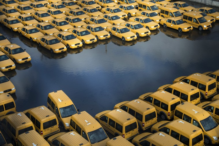 New taxi cabs are seen in a lot as flood waters recede on October 31, 2012 in Hoboken, New Jersey. Hurricane Sandy which made landfall along the New Jersey shore, has left parts of the state and the surrounding area flooded and without power. (Brendan Smialowski/Getty Images)