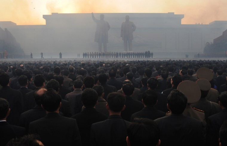 North Koreans watch fireworks during an unveiling ceremony of two statues of former leaders Kim Jong-Il (R) and Kim Il-Sung (L) in Pyongyang on April 13, 2012. North Korea's new leader Kim Jong-Un on April 13 led a mass rally for his late father and grandfather following the country's failed rocket launch. (Pedro Ugarte/Getty Images)