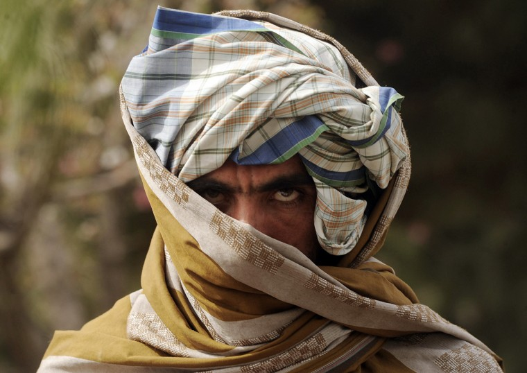 A former Taliban fighter looks on after joining Afghan government forces during a ceremony in Herat province on March 26, 2012. Twelve fighters left the Taliban to join government forces in western Afghanistan. The Taliban, ousted from power by a US-led invasion in the wake of the 9/11 attacks, announced earlier this month that they planned to set up a political office in Qatar ahead of talks with Washington. (Aref Karimi/Getty Images)
