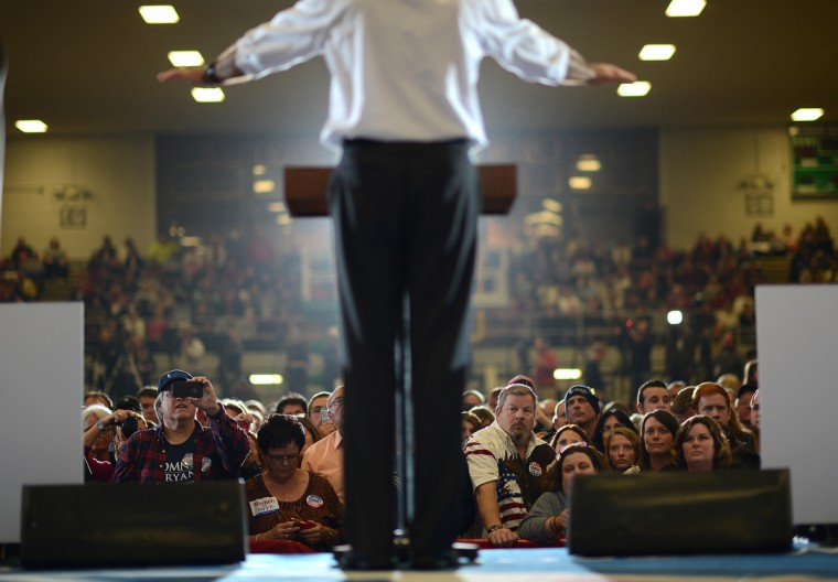 Supporters listen to US Republican Presidential candidate Mitt Romney during a rally at the Veterans Memorial Coliseum in Marion, Ohio, October 28, 2012. (Emmanuel Dunand/Getty Images)
