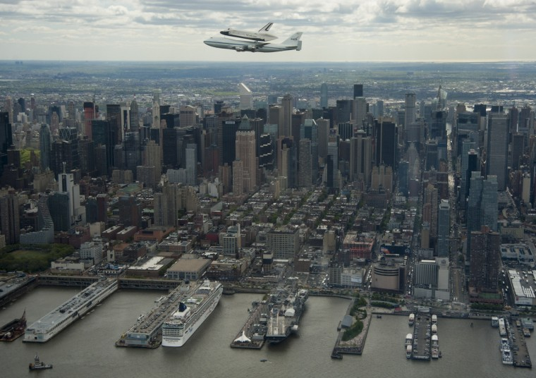 Space shuttle Enterprise, mounted atop a NASA 747 Shuttle Carrier Aircraft (SCA), flys near the Intrepid Sea, Air and Space Museum on April 27, 2012, in New York. Enterprise was the first shuttle orbiter built for NASA performing test flights in the atmosphere and was incapable of spaceflight. Originally housed at the Smithsonian's Steven F. Udvar-Hazy Center, Enterprise will be demated from the SCA and placed on a barge that will eventually be moved by tugboat up the Hudson River to the Intrepid Sea, Air and Space Museum in June. (Robert Markowitz/NASA/Getty Images)