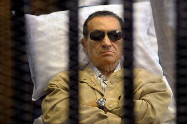 Ousted Egyptian president Hosni Mubarak sits inside a cage in a courtroom during his verdict hearing in Cairo on June 2, 2012. A judge sentenced Mubarak to life in prison after convicting him of involvement in the murder of protesters during the uprising that ousted him last year. (Getty Images)