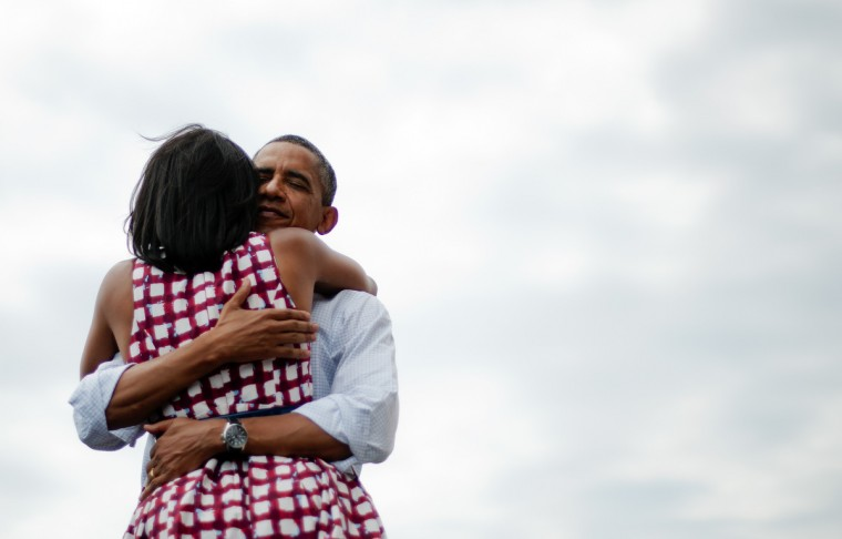 First Lady Michelle Obama (L) and US President Barack Obama (R) hug after delivering remarks during a campaign event at the Alliant Energy Amphitheater in Dubuque, Iowa, August 15, 2012, during his three-day campaign bus tour across the state. The image also became the most retweeted photo ever with over 818,933 retweets and 303,515 favorites. (Jim Watson/Getty Images)