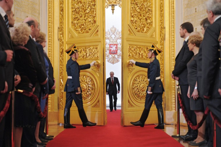 Russia's President Vladimir Putin (C) enters Andreyevsky (St.Andrew's ) Hall at the Great Kremlin Palace in Moscow's Kremlin, on May 7, 2012, during his inauguration ceremony. Putin took his oath of office today to become Russia's president for a historic third mandate at a glittering ceremony inside the Kremlin. (AlexeyDruzhinin/Getty Images)