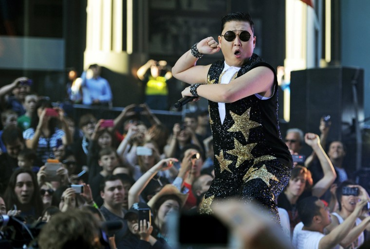 """South Korean pop sensation Psy, whose real name is Park Jae-Sang, performs for fans at a promotion by the Sunrise breakfast television show in central Sydney on October 17, 2012. The 34-year-old Psy has rocketed to international fame with his song """"Gangnam Style"""" and its much-imitated dance moves which has gone viral on YouTube. (Greg Wood/Getty Images)"""