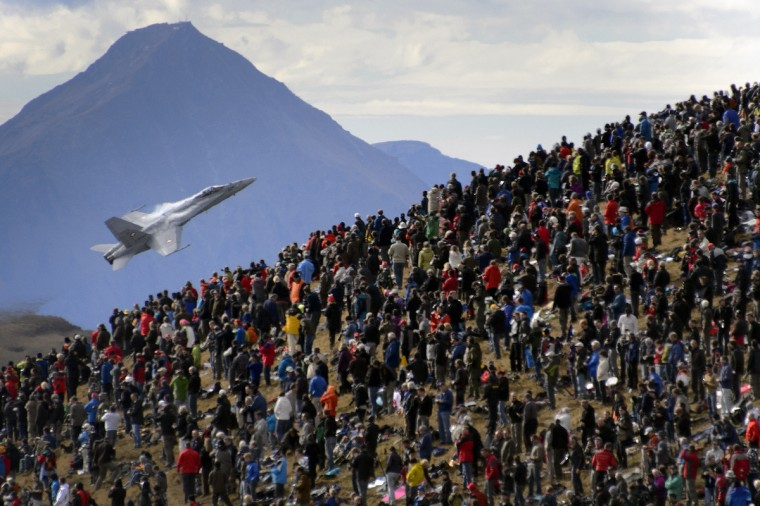 A crowd watches an F/A-18 Hornet fighter aircraft of the Swiss Air Force on October 11, 2012 doing a flight demonstration of the Swiss Air Force over Axalp in the Bernese Oberland. (Fabrice Coffrini/Getty Images)