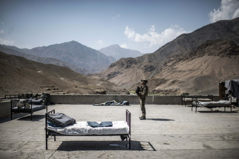 A French soldier stands on a rooftop of an Afghan National Police (ANP) combat post on September 24, 2012, in a village on the road to Naghlu the French army base. Beds are used by the policemen to sleep outside due to the heat. France is the fifth largest contributor to NATO's International Security Assistance Force (ISAF), which is due to pull out the vast majority of its 130,000 troops by the end of 2014. (Jeff Pachoud/Getty Images)
