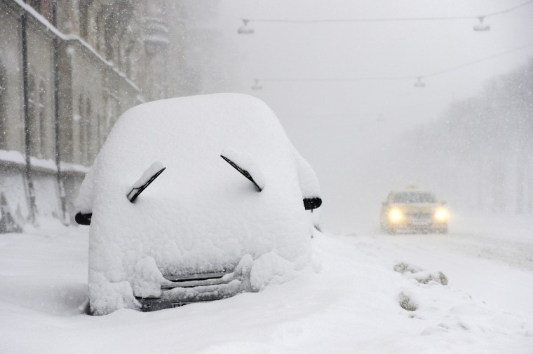A parked car seen covered with snow during a blizzard in Stockholm, Sweden . (Jonathan Nackstrand/Getty Images)