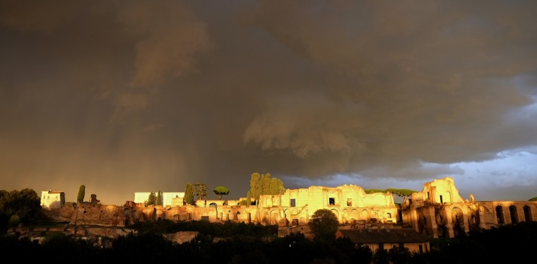 Circus Maximus is seen as the sun breaks through a cloudy sky in Rome. (Alberto Pizzoli/Getty Images)