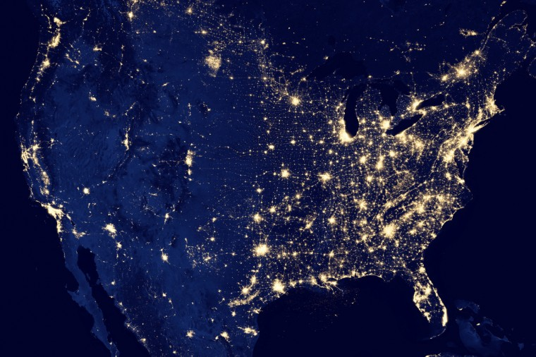 "The continental United States. The image was made possible by the satellite's ""day-night band"" of the Visible Infrared Imaging Radiometer Suite (VIIRS), which detects light in a range of wavelengths from green to near-infrared and uses filtering techniques to observe dim signals such as city lights, gas flares, auroras, wildfires and reflected moonlight. Many satellites are equipped to look at Earth during the day, when they can observe our planet fully illuminated by the sun. With a new sensor aboard the NASA-NOAA Suomi National Polar-orbiting Partnership (NPP) satellite launched last year, scientists now can observe Earth's atmosphere and surface during nighttime hours. (NASA Earth Observatory)"