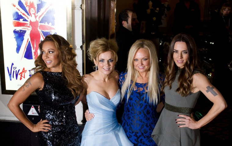 Members of the British pop girl group Spice Girls (From L-R) Melanie Brown, Geri Halliwell, Emma Bunton and Melanie Chisholm pose for pictures on the red carpet as they arrive for the premiere of the Spice Girls musical 'Viva Forever' in central London. 'Viva Forever' is produced by Judy Craymer, written by Jennifer Saunders and features the music of the Spice Girls. (Leon Neal/AFP/Getty Images)