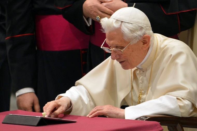 Pope Benedict XVI clicks on a tablet to send his first twitter message during his weekly general audience at the Paul VI hall at the Vatican. Pope Benedict XVI sent his first Twitter message from a digital tablet on Wednesday using the handle @pontifex, blessing his hundreds of thousands of new Internet followers. (Vincenzo Pinto/Getty Images)