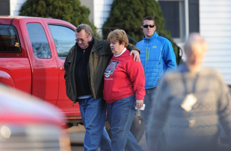 Grieving residents gather following a shooting at Sandy Hook Elementary School in Newtown, Connecticut. (Don Emmert/Getty Images)