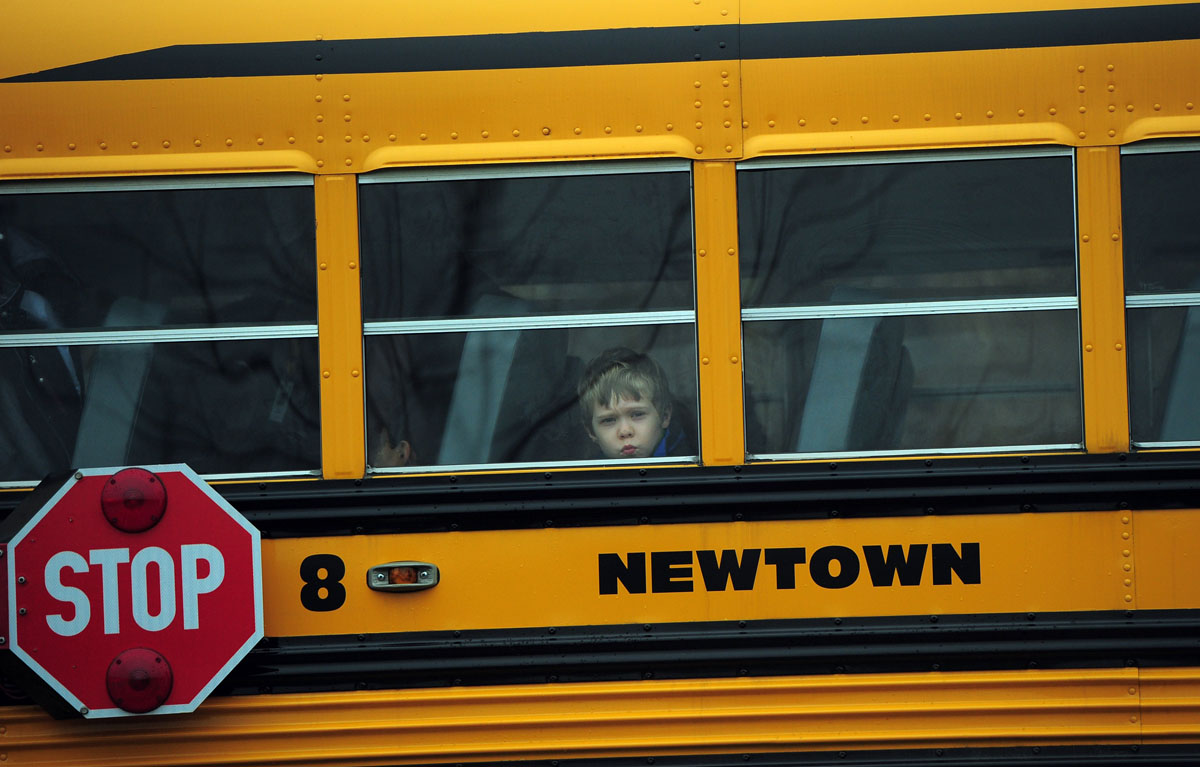 Dec. 18 Photo Brief: Schools reopen in Newtown, Queen Elizabeth joins the Cabinet, fisherman process a dead shark, a swordfish and a whale
