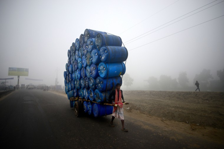 A Bangladeshi labourer pulls a cart full of empty drums during a nationwide strike in Dhaka. Twelve like-minded Islamic parties called an eight-hour general strike in the capital Dhaka and a dawn-to-dusk general strike across the country as they seek a ban on left-wing political parties. (Munir uz Zaman/Getty images)