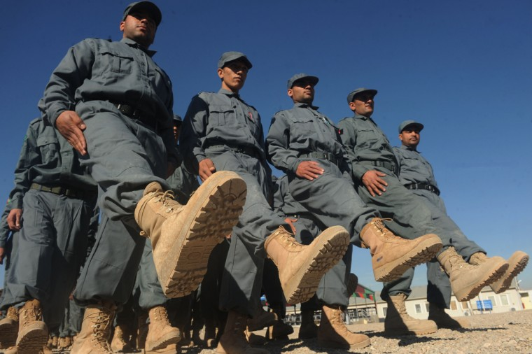 Afghan National Police (ANP) march during a graduation ceremony at a police training centre in Herat. Four Afghan policemen were shot dead and three wounded after their colleague poisoned them in southern Afghanistan on December 19, officials said. (Aref KarimiAref Karimi/Getty Images)
