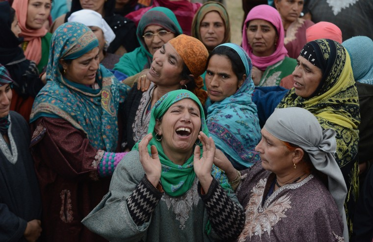 Kashmiri muslim woman mourn during the funeral of Lashkar-e-Toiba militant, Imtiyaz Ahmed in Pulwama some 55kms south of Srinagar on December 28,2012. Indian troops shot dead two suspected Islamic militants in Kashmir while seven civilians received police bullet injuries when they protested the slaying of the rebels, officials said. The two militants belonging to the Pakistan-based Lashkar-e-Taiba rebel group were killed while three troopers were wounded in a firefight with militants in Pulwama town, 30 kilometres (19 miles) from Kashmir summer capital Srinagar. (Tauseef Mustafa/Getty Images)