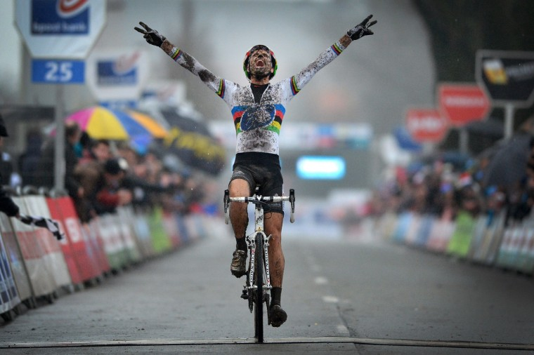 Belgian Niels Albert celebrates as he crosses the finish line to win the Azencross (Cross des As), the fifth stage in the Bpost Bank Trofee Cyclocross competition in Loenhout. (David Stockman/Getty Images)