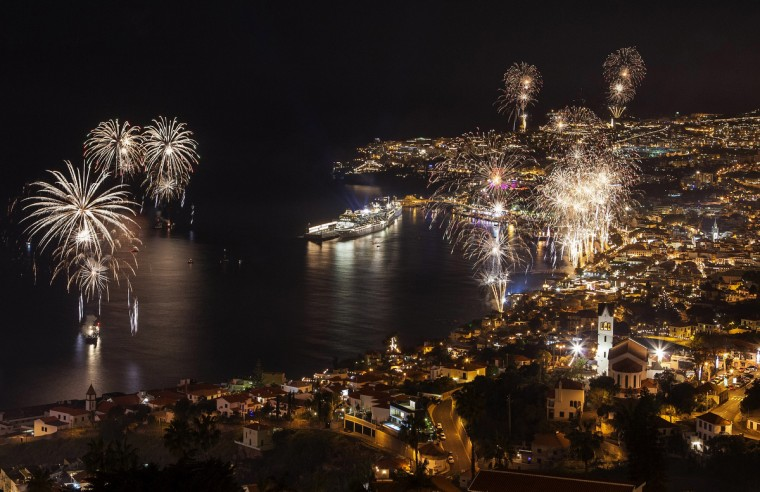 Fireworks light up the sky above Funchal Bay, Madeira Island, to celebrate the arrival of the New Year. (Gregorio Cunha/Getty Images)