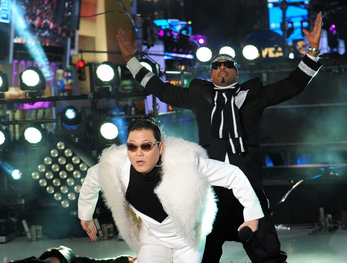 South Korean singer PSY performs with US singer MC Hammer (R) during New Year's Eve celebrations in Times Square in New York. (Emmanuel Dunand/Getty Images)