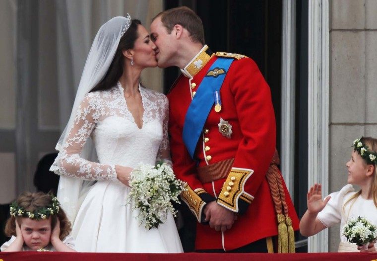 Their Royal Highnesses Prince William, Duke of Cambridge and Catherine, Duchess of Cambridge kiss on the balcony at Buckingham Palace on April 29, 2011 in London, England. (Peter Macdiarmid/Getty Images)