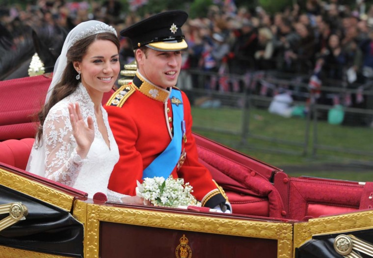 Their Royal Highnesses Prince William, Duke of Cambridge and Catherine, Duchess of Cambridge make the journey by carriage procession to Buckingham Palace past crowds of spectators following their marriage at Westminster Abbey on April 29, 2011 in London, England. (Dimitar Dilkoff - WPA Pool/Getty Images)