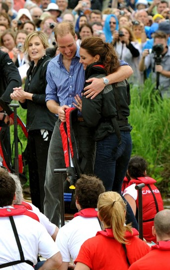 Prince William, Duke of Cambridge hugs his wife Catherine, Duchess of Cambridge after the team he rowed in won a Dragon boat race, in which they competed against each other, across the Dalvay lake on July 4, 2011 in Charlottetown, Canada. (John Stillwell - Pool/Getty Images)