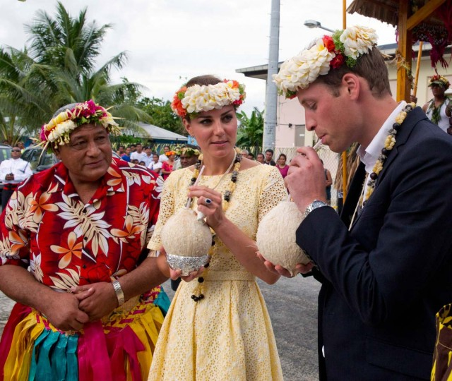 Prince William, Duke of Cambridge and Catherine, Duchess of Cambridge drink coconut milk from a tree planted by the Queen in 1982 on September 18, 2012 in Tuvalu. (Arthur Edwards - Pool/Getty Images)