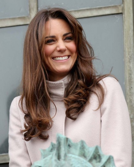 Catherine, Duchess of Cambridge smiles and waves to the crowds from the balcony of Cambridge Guildhall as she pays an official visit to Cambridge with Prince William, Duke of Cambridge on November 28, 2012 in Cambridge, England. (Chris Jackson/Getty Images)
