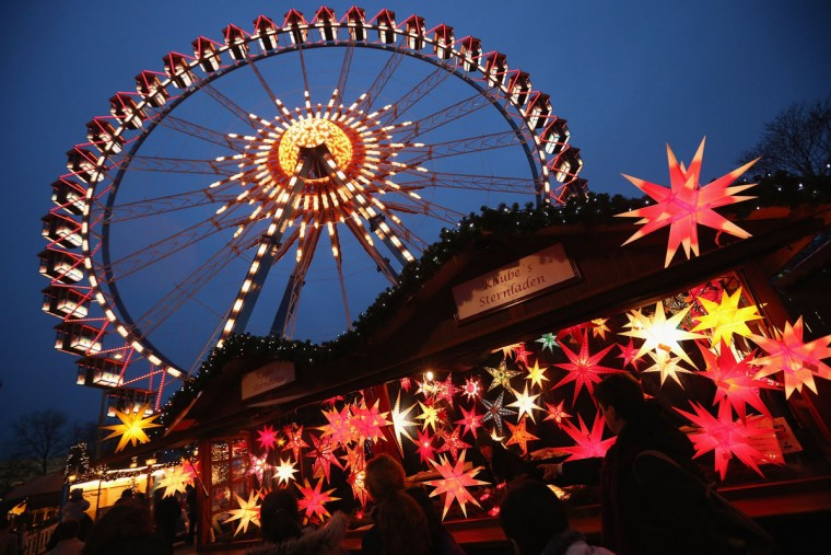 Visitors walk past a stall selling illuminated Christmas stars at the annual Christmas market at Alexanderplatz two days on November 28, 2012 in Berlin, Germany. Christmas markets, with their stalls selling mulled wine (Gluehwein), Christmas tree decorations and other delights, are an integral part of German Christmas tradition. (Sean Gallup/Getty Images)