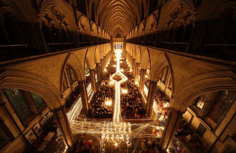 In this multiple exposed photo, Salisbury Cathedral is illuminated by trails of candles carried by choristers during the annual 'darkness to light' advent procession on December 1, 2012 in Salisbury, England. (Matt Cardy/Getty Images)