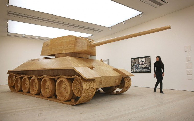 A visitor looks at artist Amy Cheung's full size wooden 'Toy Tank' at the 'Hong Kong Eye' exhibition at Saatchi Gallery in London, England. The Hong Kong Eye Presented by Prudential is the first major international showcase of contemporary art from the city anywhere in the world and runs from December 5, 2012 to January 12, 2013. (Peter Macdiarmid/Getty Images for the Saatchi Gallery)