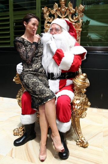 Dannii Minogue poses with Santa Claus as she attends the Women In Media Christmas Luncheon held at Breezes restaurant, Crown Towers on December 6, 2012 in Melbourne, Australia. (Graham Denholm/Getty Images)
