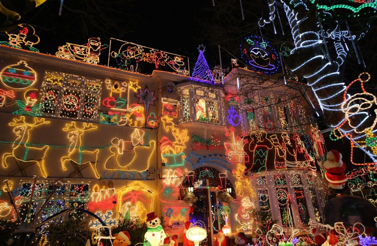 Christmas festive lights adorn a detached house in a suburban street in Melksham, England. The lights, a popular festive attraction, have returned to the town after a two-year absence and have raised thousands of pounds for charity for a local hospice, Dorothy House. The display, which is estimated to involve over 100,000 bulbs and cost over 30,000 British pounds, even needed an uprated electricity supply installed to cope with the additional power required. This year, the display took a team of professional electricians five weeks to complete and includes a snow machine. (Matt Cardy/Getty Images)