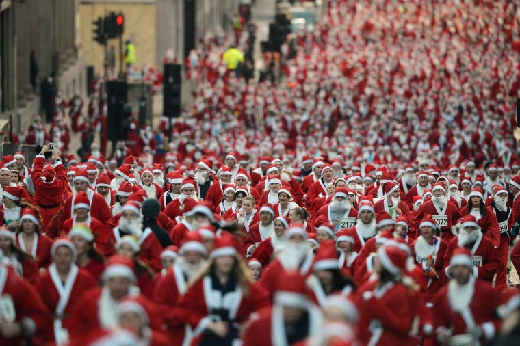A thousand people take part in the annual Glasgow Santa Dash on December 9, 2012 in Glasgow, Scotland. (Jeff J Mitchell/Getty Images)