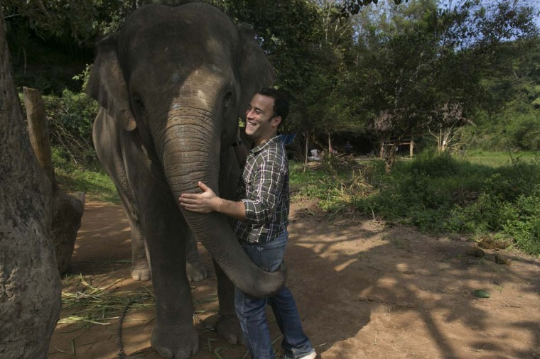 Meet Blake Dinkin, founder of Black Ivory Coffee. Here he hugs an elephant at the Anantara Golden Triangle resort in Golden Triangle, northern Thailand. Black Ivory Coffee is made from Thai arabica hand picked beans. The coffee is created from a process whereby coffee beans are naturally refined by a Thai elephant. (Paula Bronstein/Getty Images)