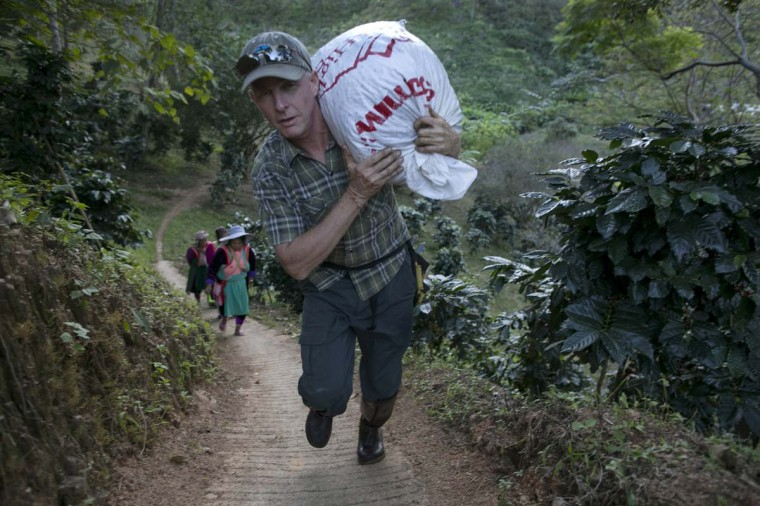 Ray Buerger, owner of Thai High Ventures, carries a large bag of freshly picked coffee beans at the Thai High coffee farm on December 8, 2012 in Phrao, northern Thailand. The organic fair trade coffee farm was chosen to help produce the Black Ivory Coffee. (Paula Bronstein/Getty Images)