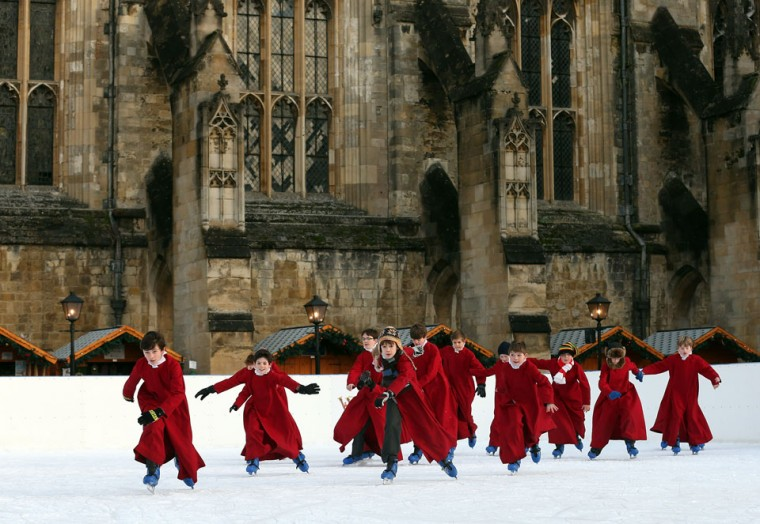 Choristers from Winchester Cathedral don ice-skates to enjoy the artificial rink set up beside the cathedral in Winchester, England. (Matt Cardy/Getty Images)