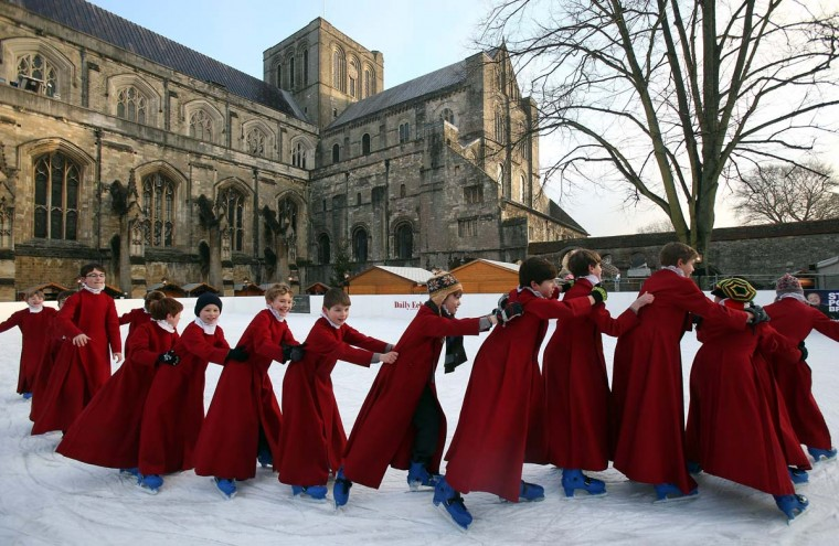 Choristers from Winchester Cathedral don ice-skates to enjoy the artificial rink set up beside the cathedral on December 11, 2012 in Winchester, England. (Matt Cardy/Getty Images)