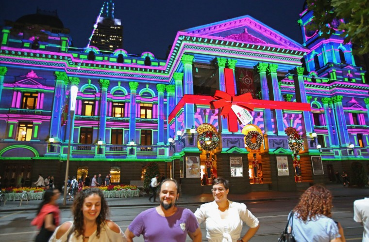 People look on as Melbourne Town Hall is illuminated with Christmas projections on December 13, 2012 in Melbourne, Australia. (Scott Barbour/Getty Images)